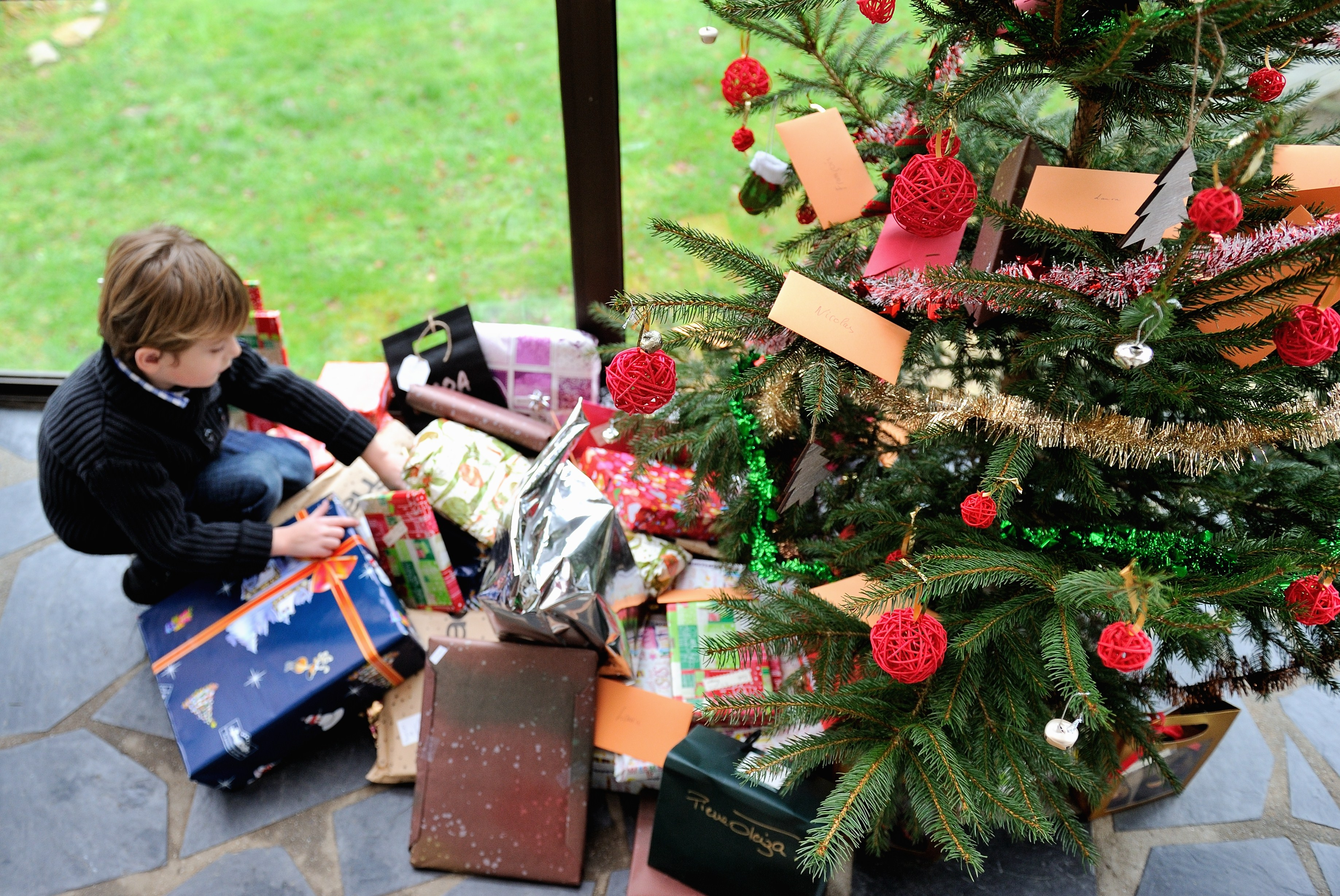 Underprivileged kids choose christmas gifts