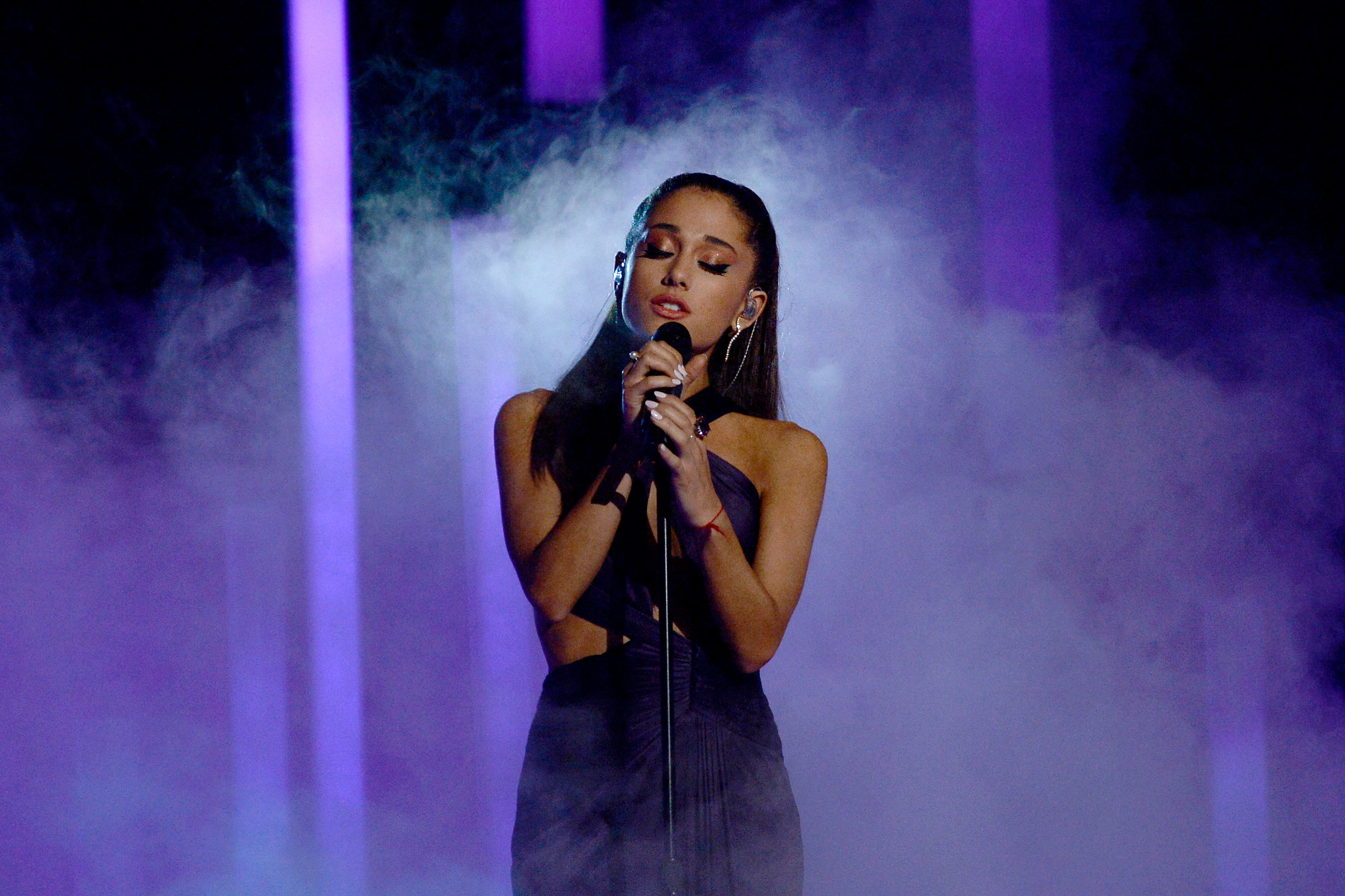 8 Ariana Grande Songs For Karaoke Night When You're Feeling