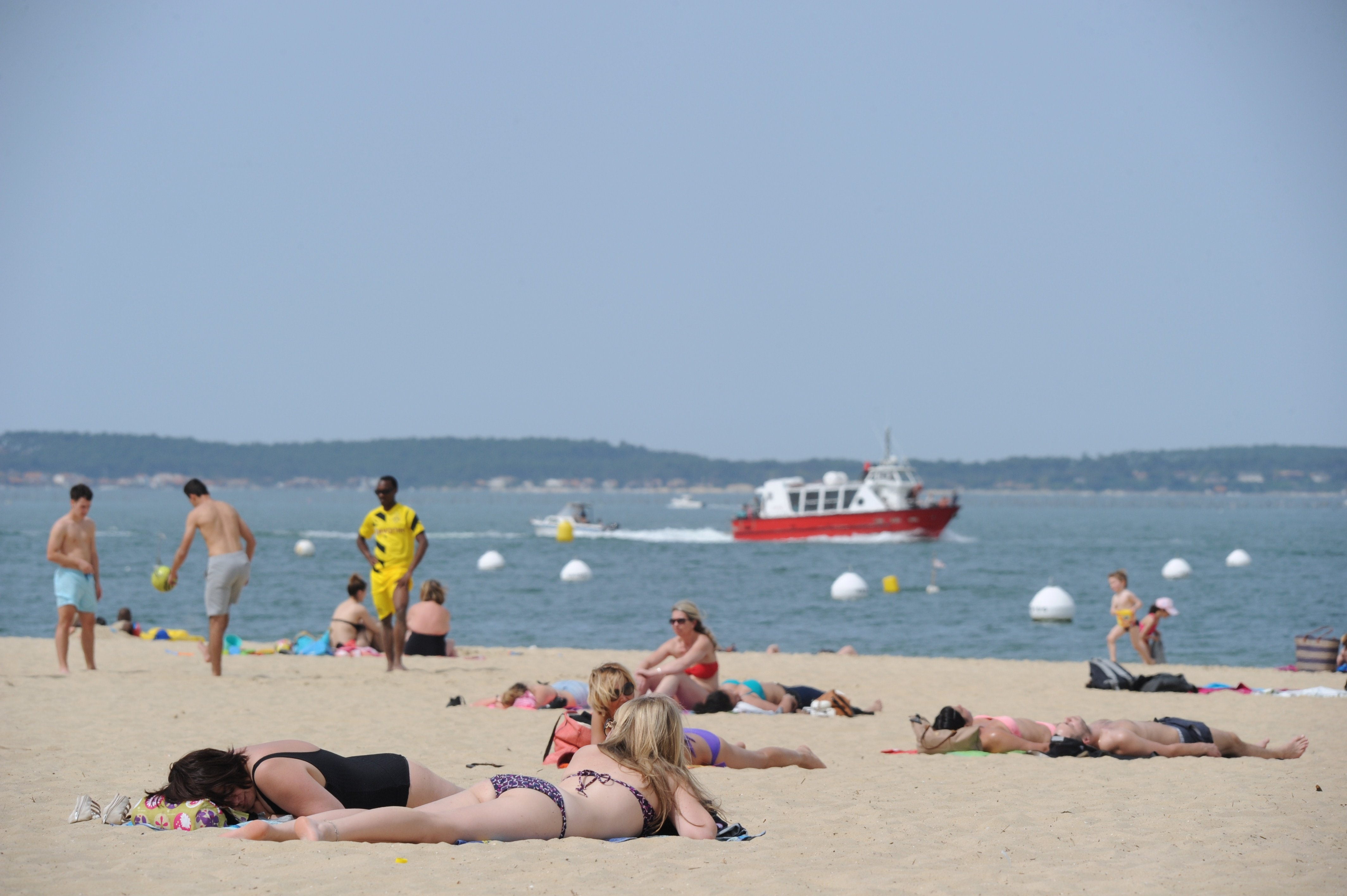 People Tanning On The Beach Source Mehdi Fedouachafpgetty Images B
