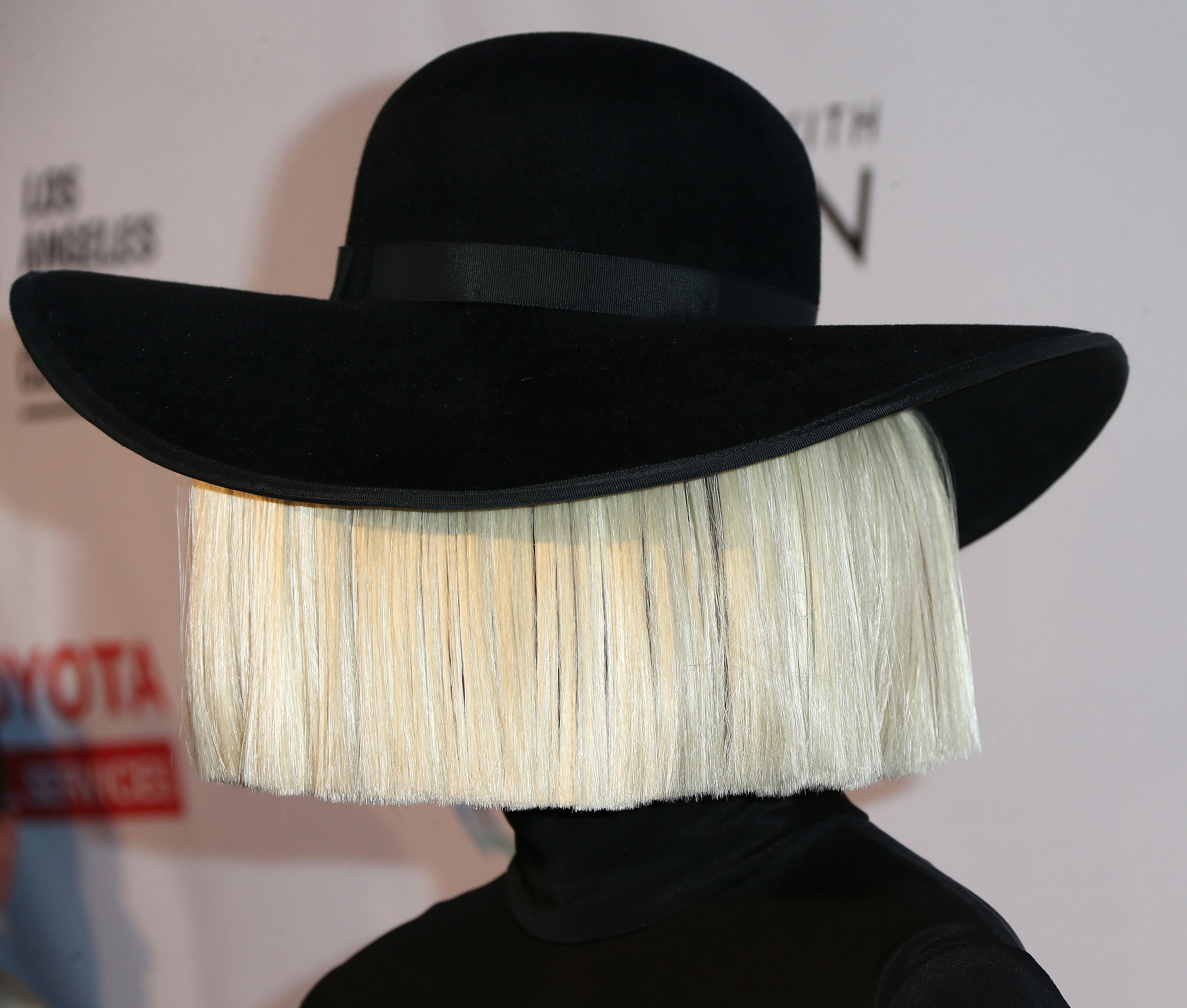 Sia Reveals The Mystery Behind Her Wigs   It s For A Deeper Reason Than You  Probably Expected — VIDEO 58532fc69b31