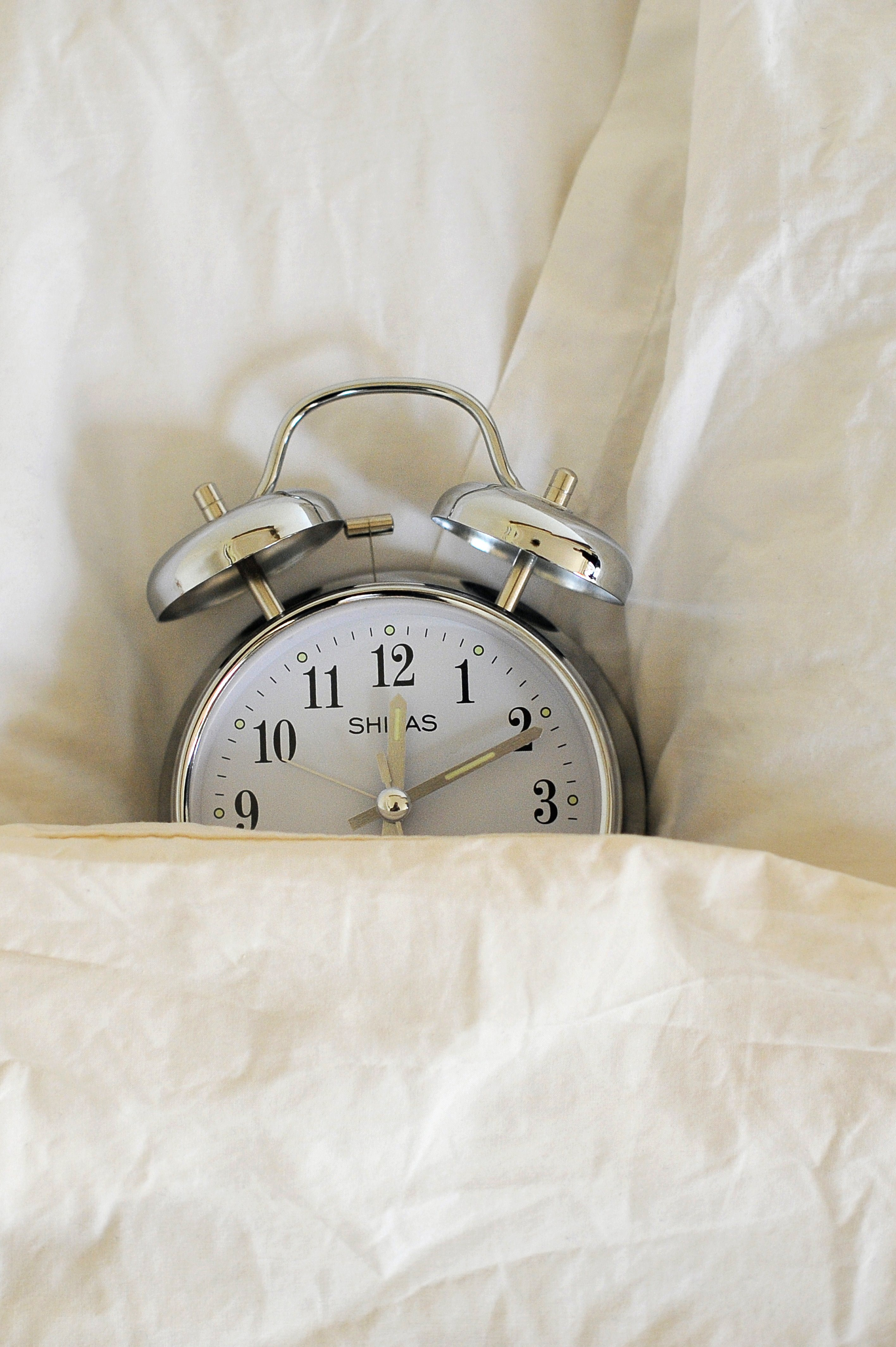 Is Hitting The Snooze Button Bad For You? Here's How It May