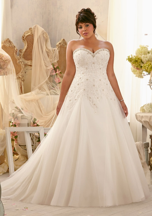 0afbc108571a8 25 Stunning Plus-Size Wedding Dresses For Every Style Of Nuptial Affair